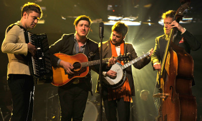 LOS ANGELES, CA - FEBRUARY 08:  (L-R) Musicians Ben Lovett, Marcus Mumford, 'Country' Winston Marshall and Ted Dwane of Mumford & Sons perform onstage at MusiCares Person Of The Year Honoring Bruce Springsteen on February 8, 2013 in Los Angeles, California.  (Photo by Larry Busacca/Getty Images for NARAS)